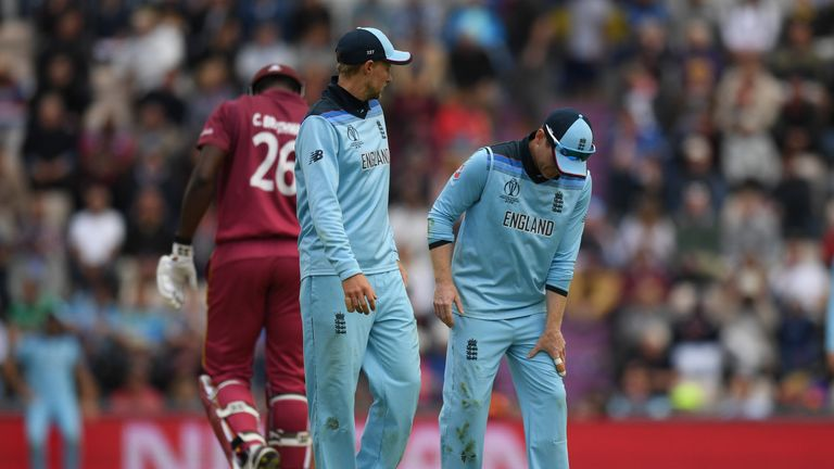 England captain Eoin Morgan feels his left leg after pulling up in the field against West Indies