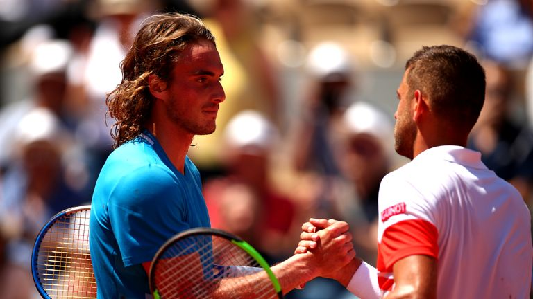 Krajinovic shakes hands with Tsitsipas after the Greek sixth seed was forced to dig deep