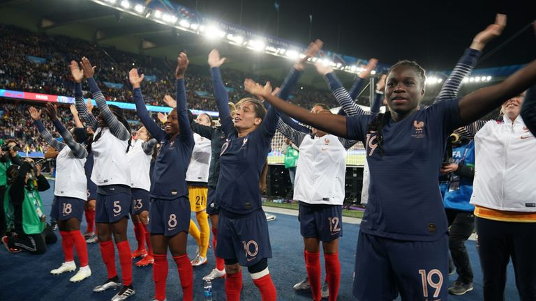 France celebrate in front of a crowd that included French President Emmanuel Macron