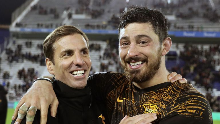 Jaguares head coach Gonzalo Quesada and number eight Javier Ortega Desio celebrate after defeating the Brumbies