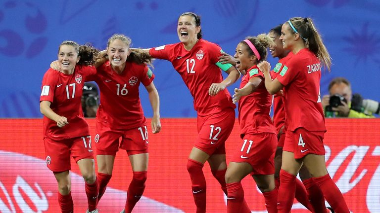 Jessie Fleming celebrates scoring for Canada