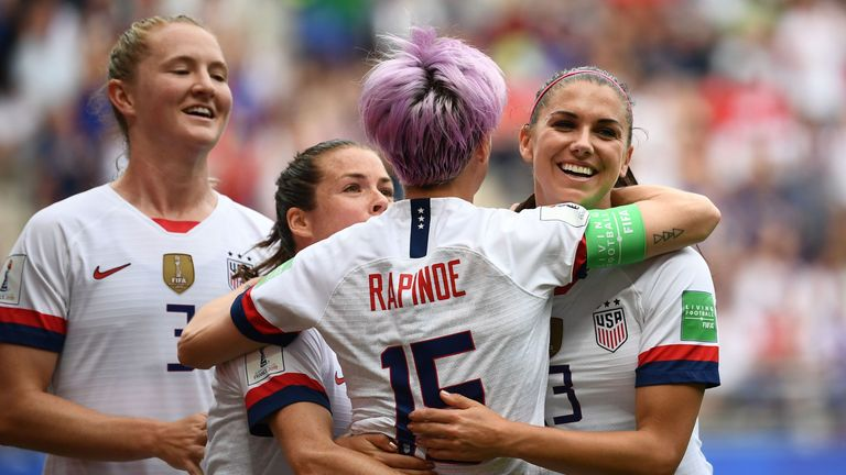 Megan Rapinoe celebrates with team-mates after her first penalty in the seventh minute