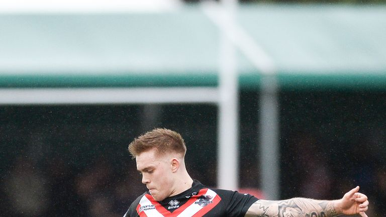 Morgan Smith kicked the winning drop-goal as the Broncos edged out St Helens