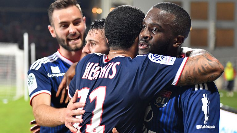 Ndombele celebrates a goal for Lyon