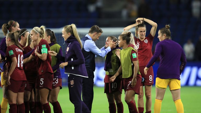 Phil Neville embraces Fran Kirby at full-time
