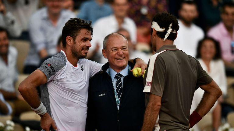 Federer and Wawrinka agreed to come off court with dark clouds gathering over Court Suzanne-Lenglen