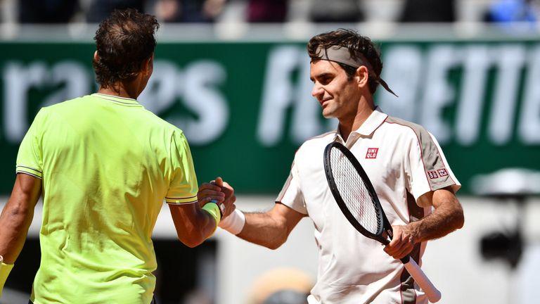 Federer congratulates Rafael Nadal at the net