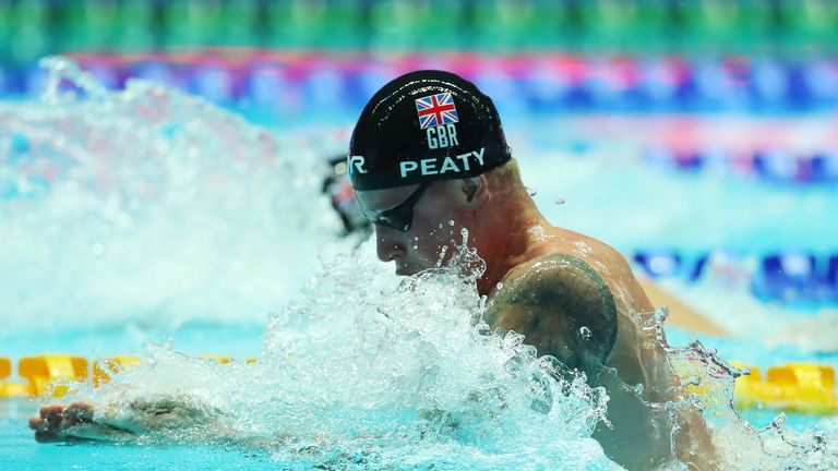 Adam Peaty claims third gold as Great Britain win 4x100m medley