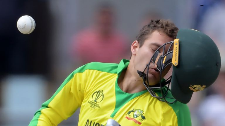 Alex Carey had his helmet knocked off by a Jofra Archer bouncer during the World Cup semi-final
