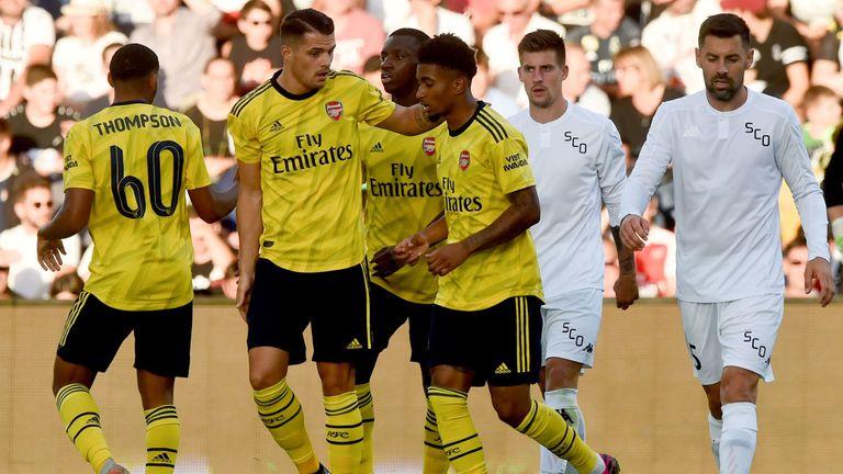 Arsenal celebrate Reiss Nelson's goal