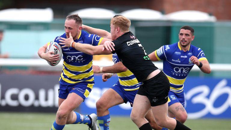 Warrington's Ben Currie fends off James Cunningham