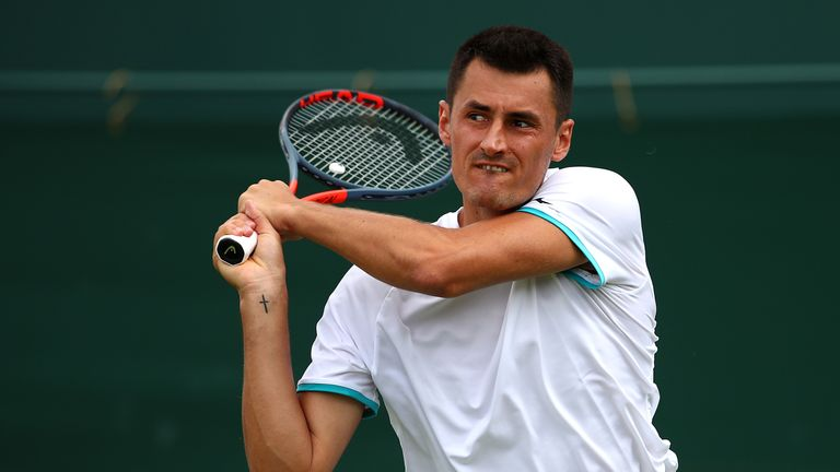 Bernard Tomic has been fined for a lack of effort in his first-round match at Wimbledon