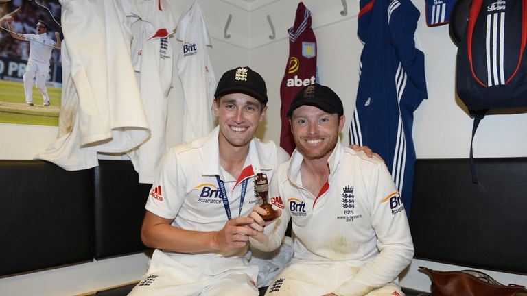 Woakes celebrates England's Ashes win in 2013 with Warwickshire team-mate Ian Bell