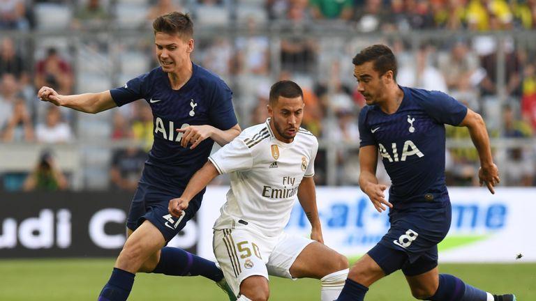 Spurs defender Juan Foyth (left) challenges Eden Hazard
