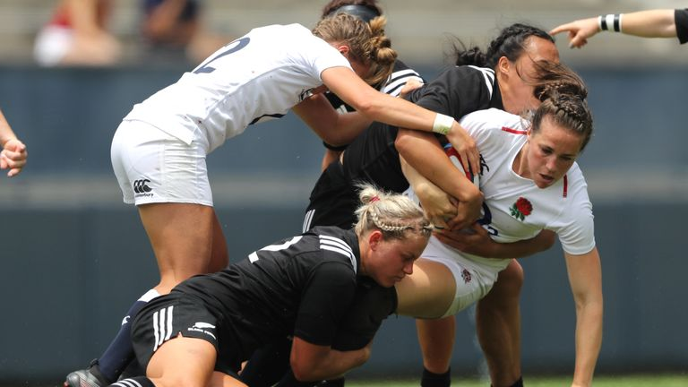 Emily Scarratt is wrapped up by the Black Ferns defence