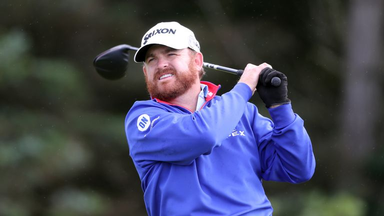 JB Holmes snatched the first-round lead from Shane Lowry