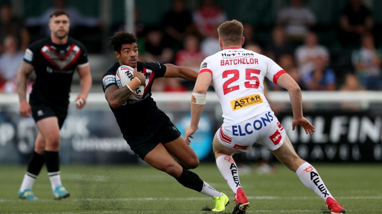 Broncos winger Kieran Dixon runs at the St Helens defence