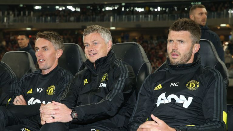 Solskjaer watches on from the sidelines with assistants Kieran McKenna and Michael Carrick