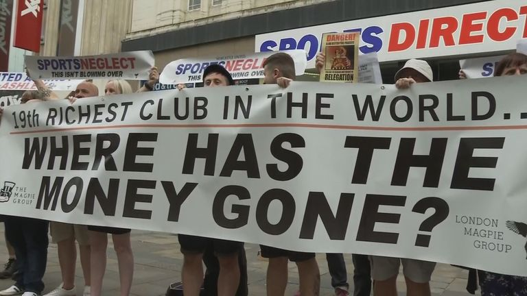 Newcastle fans from The Magpie Group take to the city's streets to protest against the club's owner Mike Ashley