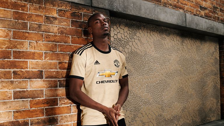 Paul Pogba models Man Utd's away kit