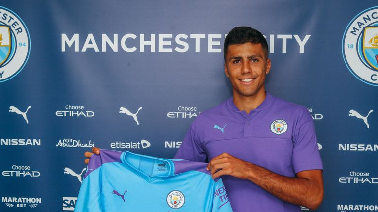 Rodri poses with City's home shirt (credit: Manchester City)
