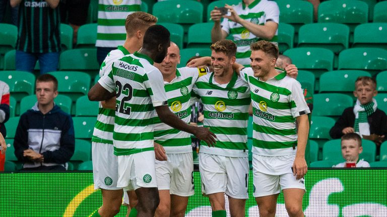 Ryan Christie celebrates with team-mates after he makes it 2-0 from the penalty spot