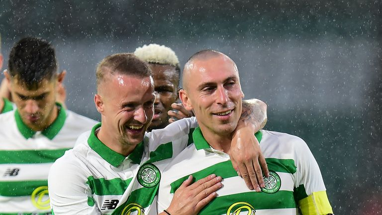 Scott Brown and Leigh Griffiths celebrate Celtic's win at full-time
