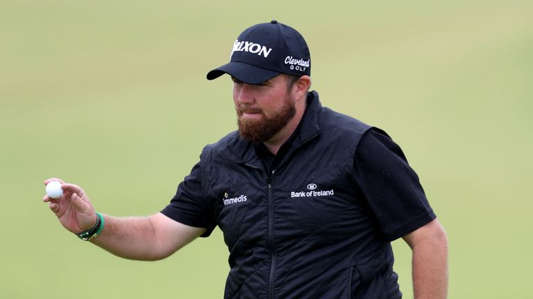 Shane Lowry celebrates a birdie on the ninth during the second round
