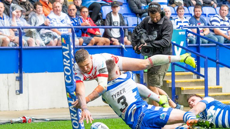 St Helens' Tommy Makinson is just pushed into touch by Stephen Tyrer