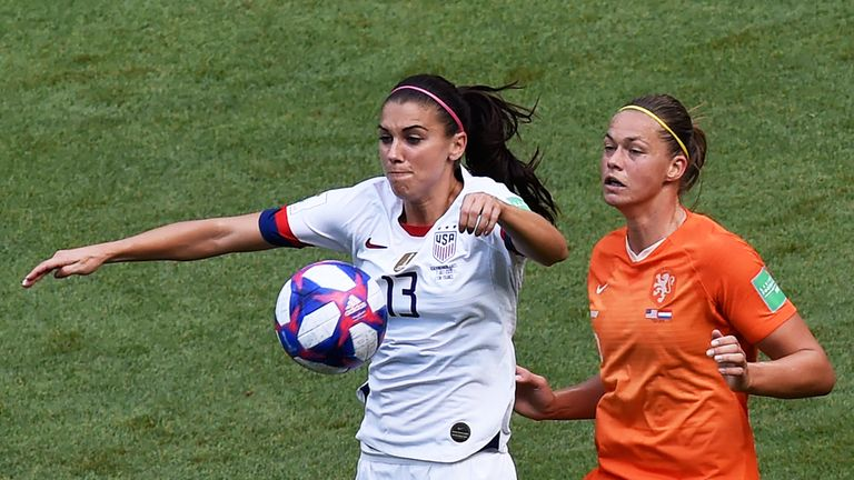Alex Morgan vies for the ball against Netherlands