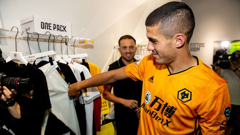 Cono Coady wore Wolves' new home kit at a Shanghai event