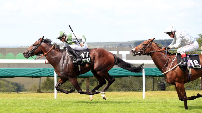 Beat Le Bon (left) ridden by Pat Dobbs on his way to winning the Unibet Golden Mile Handicap at Goodwood