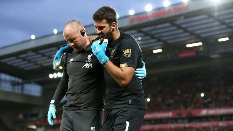 Alisson leaves the pitch after picking up a calf injury in the opening day win over Norwich