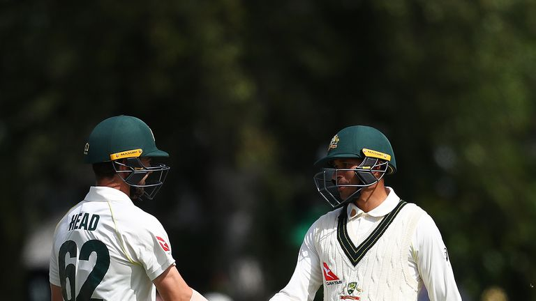 Travis Head congratulates team-mate Usman Khawaja (right) on his half-century at Worcester
