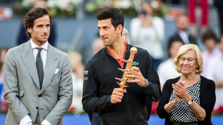 Tournament director Lopez watches on as Novak Djokovic celebrates his Madrid Open title in May