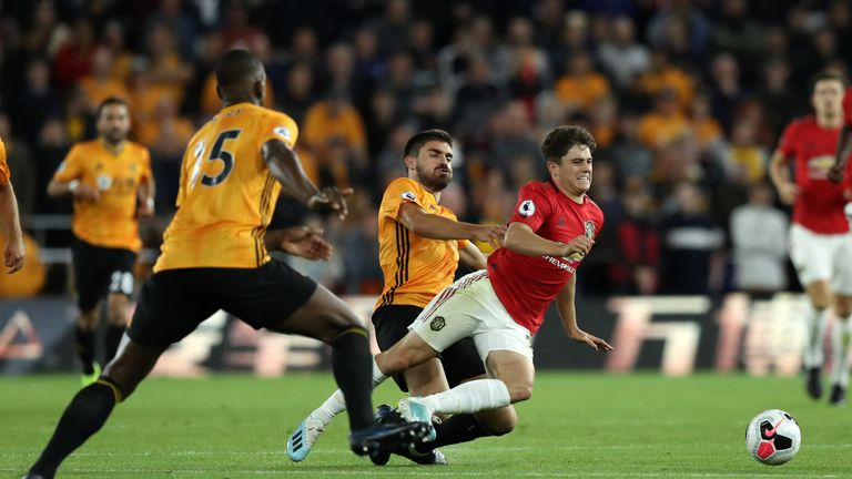 James is tackled by Wolves midfielder Ruben Neves