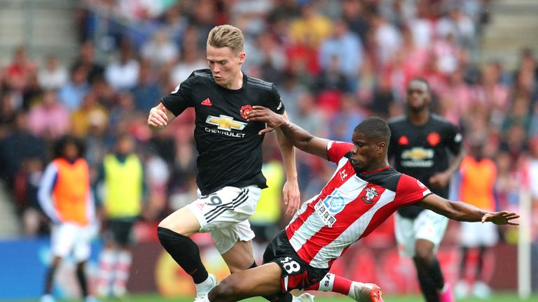 Kevin Danso was sent off after picking up a second booking for this tackle on Scott McTominay