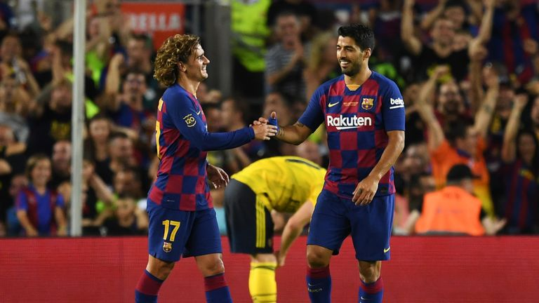 Barcelona forwards Griezmann and Suarez celebrate after Maitland-Niles' own goal