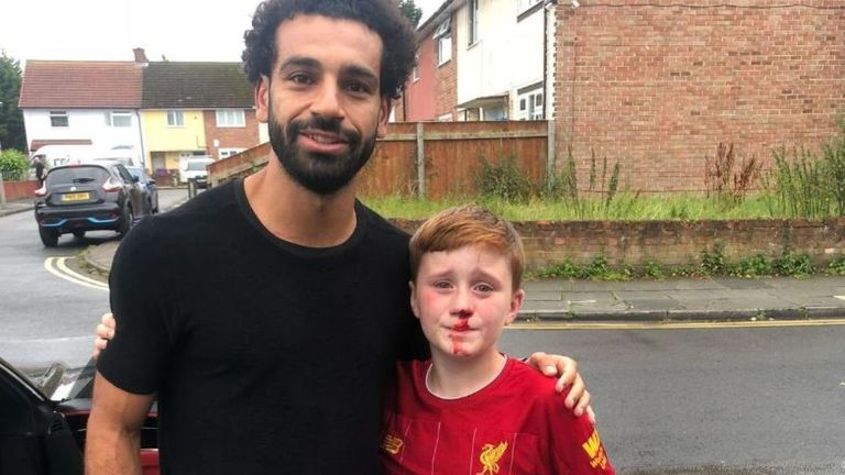 Boy meets Mo Salah after lamppost collision while chasing his hero
