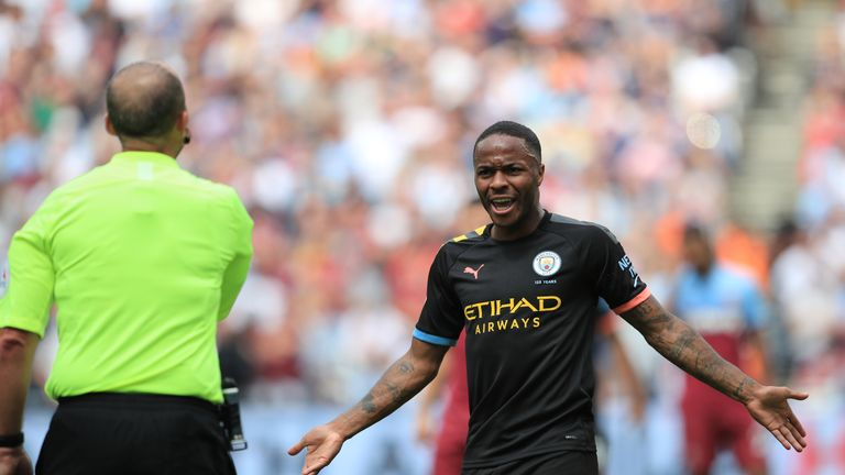 Sterling gestures towards referee Mike Dean after Manchester City's third goal is disallowed by VAR