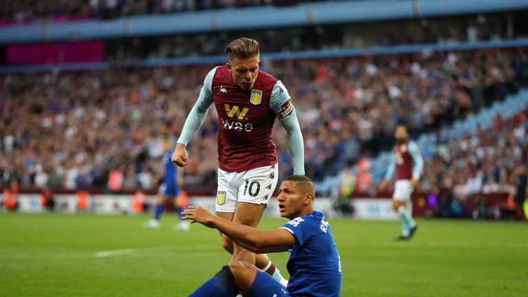 Richarlison appeals for a penalty under a challenge from Jack Grealish