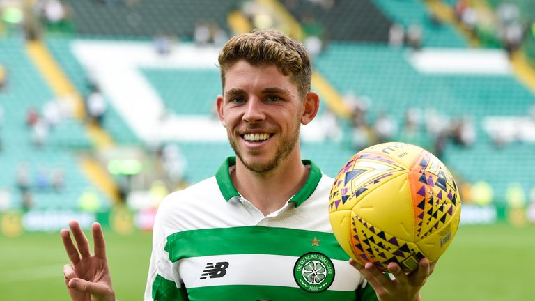 Ryan Christie celebrates with the match ball after scoring a hat-trick in Celtic's 7-0 victory