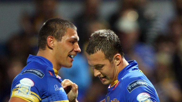 Ryan Hall and Danny McGuire both scored hat-tricks in a huge Rhinos victory