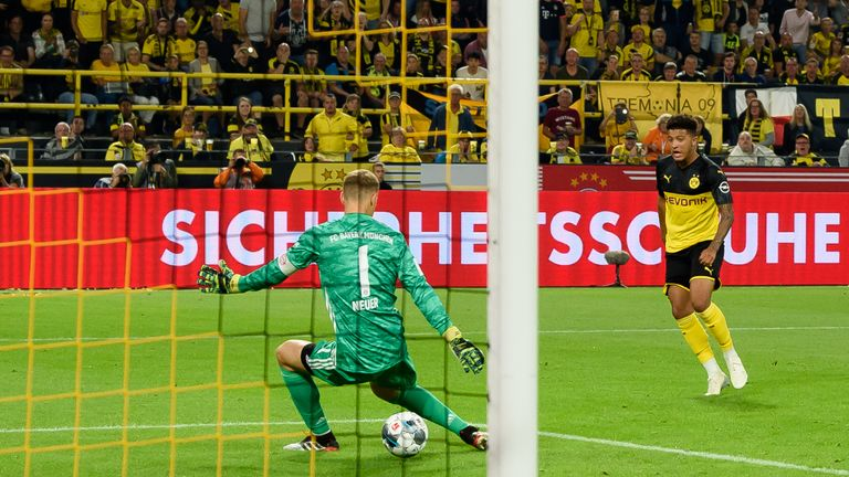 Sancho drills Dortmund's second through the legs of Manuel Neuer