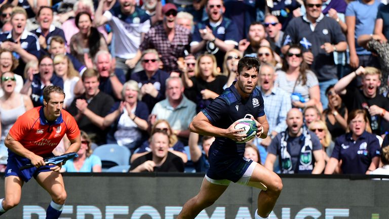 The crowd react as Sean Maitland receives the ball and charges for the try line