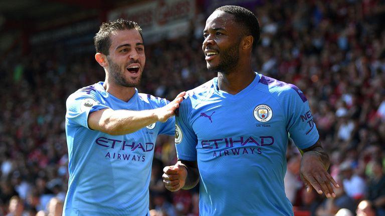 Bernardo Silva celebrates with goalscorer Raheem Sterling as Manchester City net their second goal