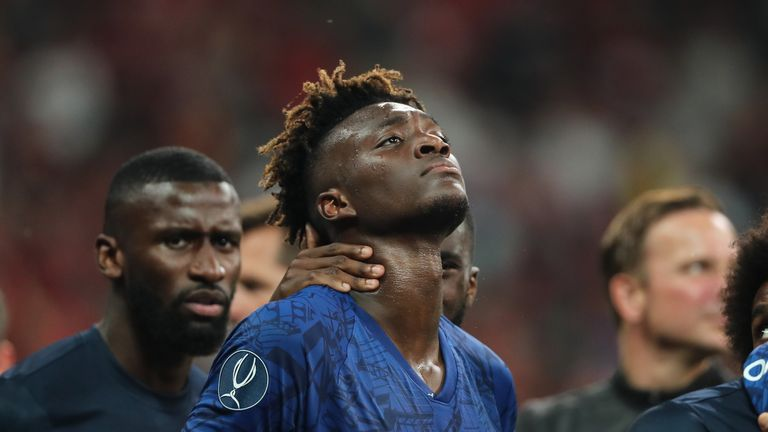 Tammy Abraham is consoled by Chelsea team-mates after their shootout defeat in the Super Cup