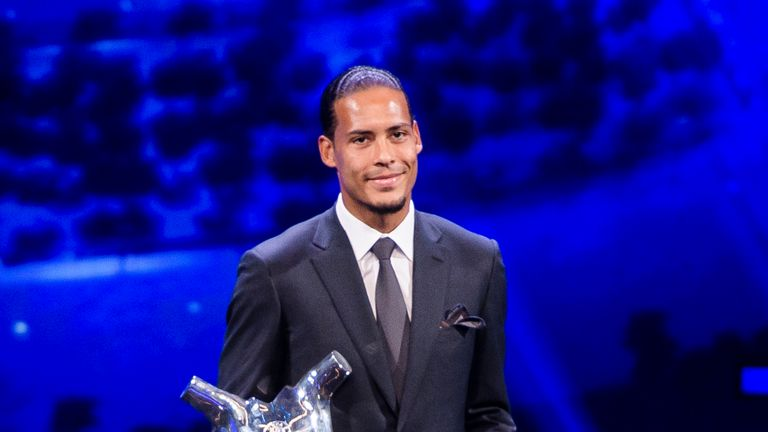 Virgil van Dijk poses with the UEFA Men's Player of the Year award