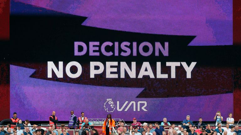 A big screen at the London Stadium displays the VAR decision not to award West Ham a penalty