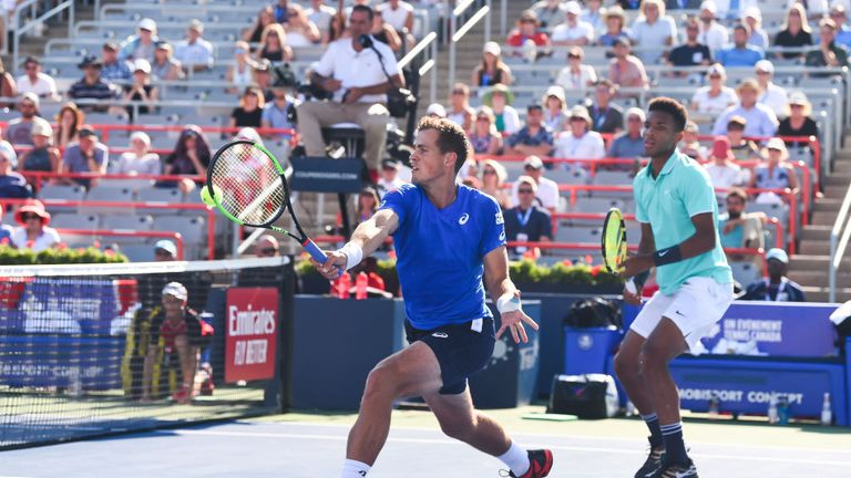 Canadians Felix Auger-Aliassime andVasek Pospisil lost in the doubles on Monday